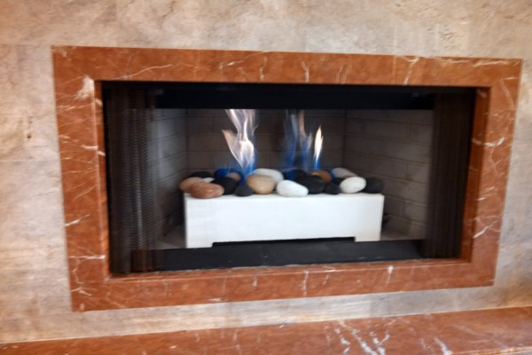 gas fireplace with river stone display